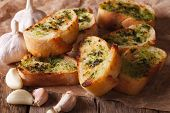 pic of french toast  - French toast with fresh herbs and garlic closeup on the table - JPG