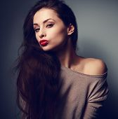 stock photo of woman red blouse  - Beautiful young woman with red lipstick in sexy blouse on dark shadow background - JPG