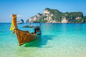 foto of phi phi  - Long boat and tropical beach Andaman Sea Phi Phi IslandsThailand - JPG