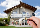 picture of mansion  - Person Hand With Magnifying Glass Over Luxury House - JPG