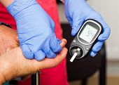 foto of diabetes mellitus  - Healthy elderly man with normal blood sugar level - JPG