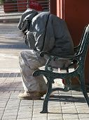 Homeless Person On The Bench