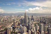 stock photo of klcc  - City skyline panorama in Kuala Lumpur - JPG