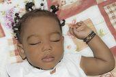 pic of cornrow  - Adorable baby girl sleeping in her room  - JPG