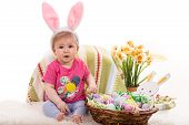 picture of baby easter  - Cute baby girl with fluffy bunny ears and basket with Easter eggs - JPG