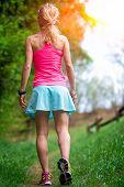 foto of girl walking away  - Youths sporty woman walking in the woods - JPG
