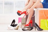 picture of shoe  - Cropped image of young woman choosing shoes in a shoe store - JPG
