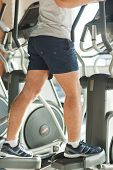 picture of cardio exercise  - Cropped image of man doing cardio exercise on step machine - JPG