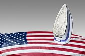 image of iron star  - Preparing for Steam iron for smooth out the wrinkles of Flag from USA - JPG