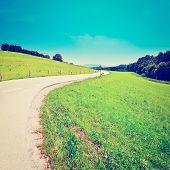 stock photo of bavaria  - Asphalt Road in Southern Bavaria Germany Retro Effect - JPG
