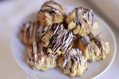 picture of icing  - Sweet eclairs with chocolate icing on the plate horizontal picture - JPG