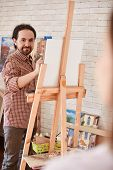 stock photo of muse  - Young man drawing muse in studio - JPG
