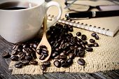 picture of sackcloth  - Cup of coffee and coffee beans on sackcloth and old wooden table - JPG