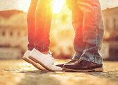 stock photo of heterosexual couple  - Couples foots stay at the street under sunlight - JPG