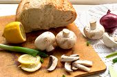 image of green onion  - whole mushrooms green onions and red onions on a wooden table cooking - JPG