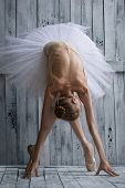 picture of tutu  - Ballerina dressed in white tutu makes lean forward - JPG