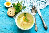 foto of meatball  - a bowl of soup with meatballs and half eggs with parsley on a wooden tray - JPG