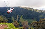 picture of swings  - Happy european woman swinging in a swing placed above Tungurahua volcano Andes mountains Ecuador