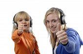 Teenage Girl And Toddler Listen Music