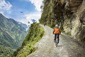 Постер, плакат: Adventure Travel Downhill Biking Road Of Death