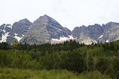 stock photo of colorado high country  - the maroon bells near aspen colorado in summer with maroon lake in the foreground - JPG