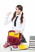 stock photo of teen pony tail  - Girl collecting books into backpack after lesson - JPG