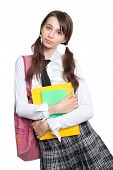 pic of teen pony tail  - puzzled schoolgirl standing with books and backpack - JPG