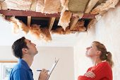 Builder And Client Inspecting Roof Damage poster