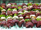 Raw venison sosaties in dish