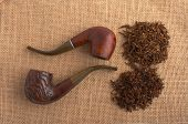 picture of peace-pipe  - two pipes and tobacco on jute material - JPG
