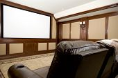 stock photo of home theater  - home theatre in a mansion with custom woodwork plush seats - JPG