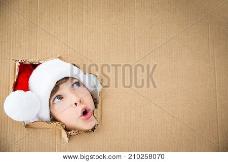 poster of Funny Kid Looking Through Hole On Cardboard