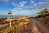Signposted Dirt Road With View Over Sea On Cyprus Island. poster
