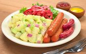 image of grilled sausage  - Sausages and potato salad with red and green onions and cucumber with a mayonnaise - JPG