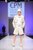 MOSCOW - FEBRUARY 22: A model wears a white suit from Slava Zaytzev and walks the catwalk in the Col