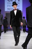 MOSCOW - FEBRUARY 22: Models wear black suits from Slava Zaytzev and walk the catwalk in the Collect