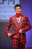MOSCOW - FEBRUARY 22: A model wears a checkered suit from Slava Zaytzev and walks catwalk in the Col