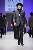 MOSCOW - FEBRUARY 22: A model wears a suit from Slava Zaytzev and walks the catwalk in the Collectio