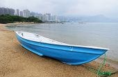 Blue boat on beach
