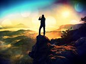 Tall Backpacker With Phone In Hand Makes Selfie. Sunny Spring Daybreak In Mountains. poster