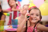 Young girl at a child's birthday party