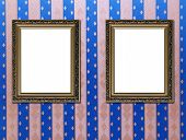 Two Old Style Vintage Golden Ornament Frames On Textured Pink And Blue Wallpaper Background