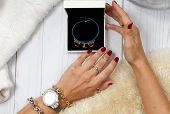 Female Hands With Gift. Fashion Accessories, Wrist Watches, Glamor Bracelets poster