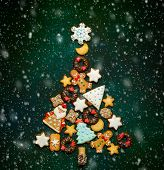 Assorted Christmas cookies in the shape of a Christmas tree on dark green background. Top view. poster