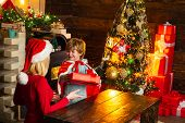 Mom And Kid Play Together Christmas Eve. Mother And Little Child Boy Adorable Friendly Family Having poster