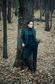 Female Hunter In Forest. Woman With Weapon. Target Shot. Military Fashion. Achievements Of Goals. Gi poster