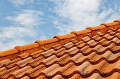 Close Up Of Brown Clay Roof Tiles. Red Old Dirty Roof. Old Roof Tiles. Construction Equipment Build poster