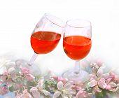 wine glasses  among spring flowers