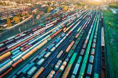 Aerial View Of Freight Trains. Colorful Cargo Wagons On Railway Station. Wagons With Goods On Railro poster