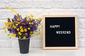 Happy Weekend Words On Black Letter Board And Bouquet Of Colored Flowers In Black Paper Coffee Cup W poster
